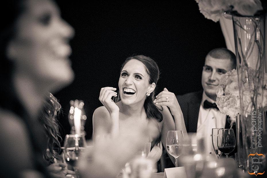 Joy laughing during toasts