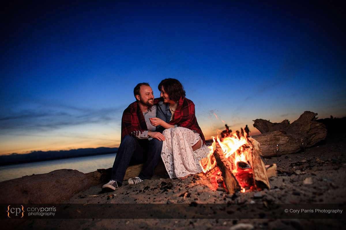 Campfire engagement portrait at Golden Gardens