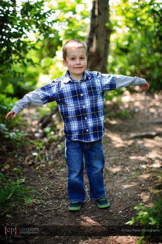 Little boy in the woods.