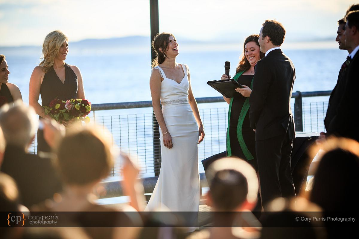 Jenny and Jesse laughing during their vows.