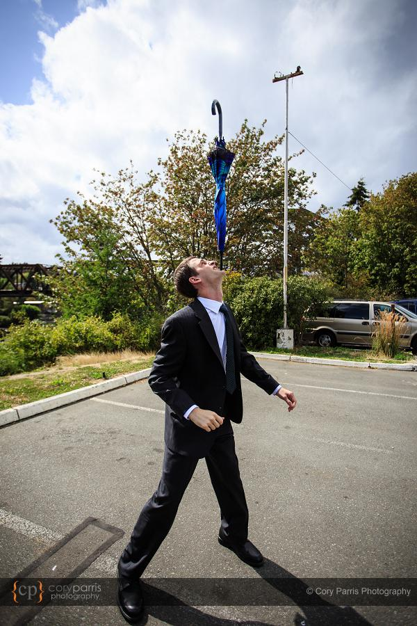 David balancing an umbrella on his chin. Evidently, he is also an impressive magician.
