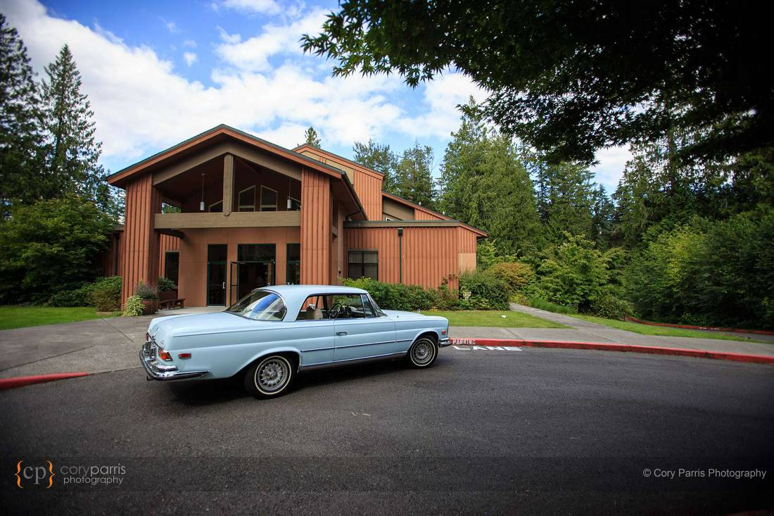 Classic baby blue Mercedes in front of the church.