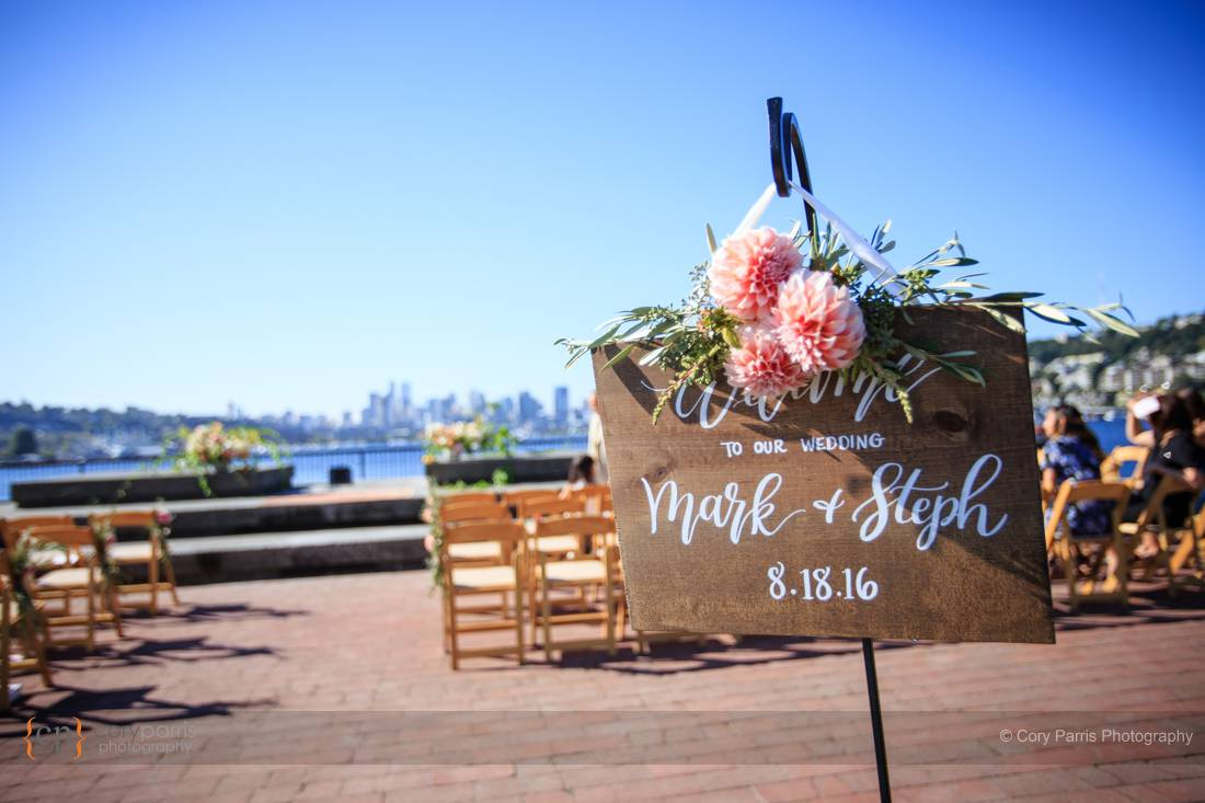 Wedding sign with Seattle in the background.