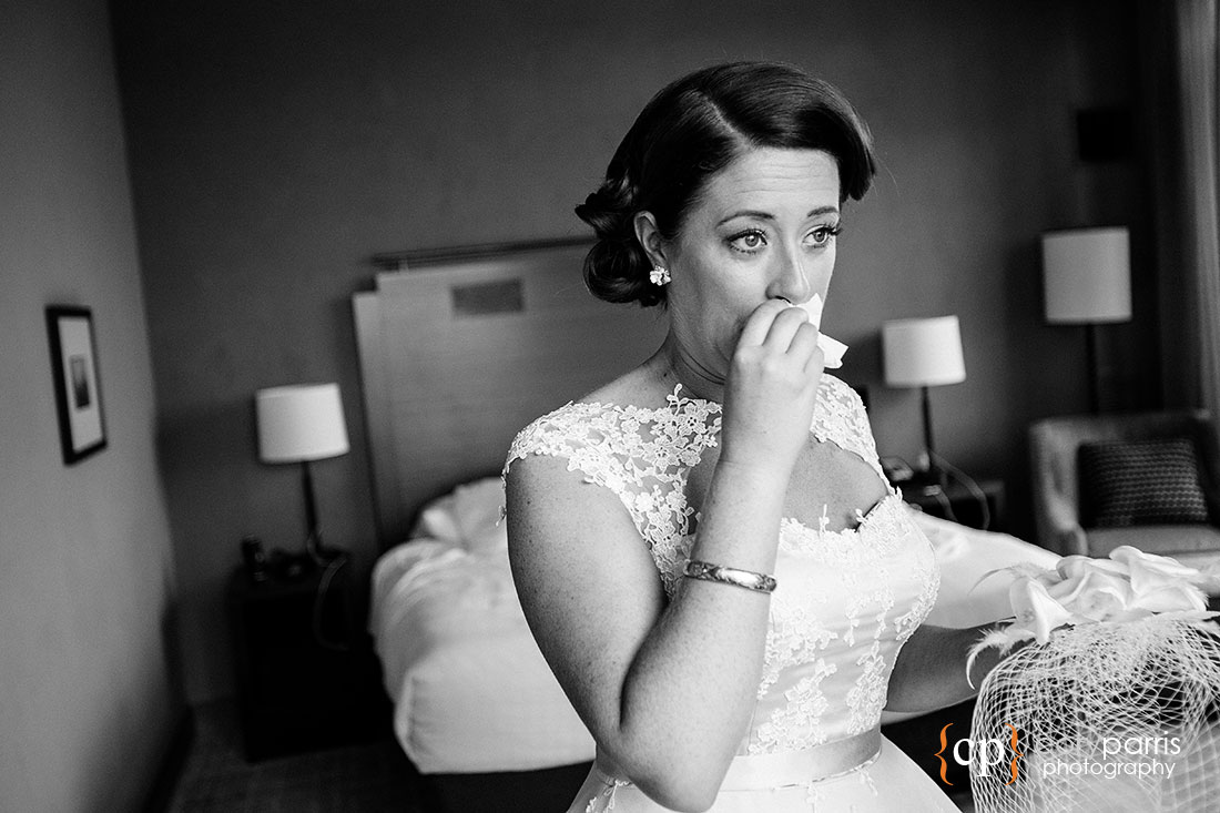 Bride crying after seeing her groom