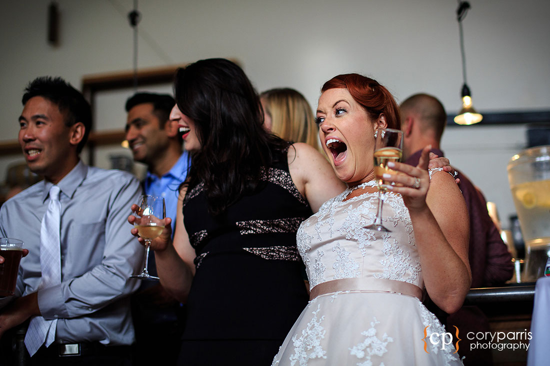 Bride laughing at seattle wedding reception