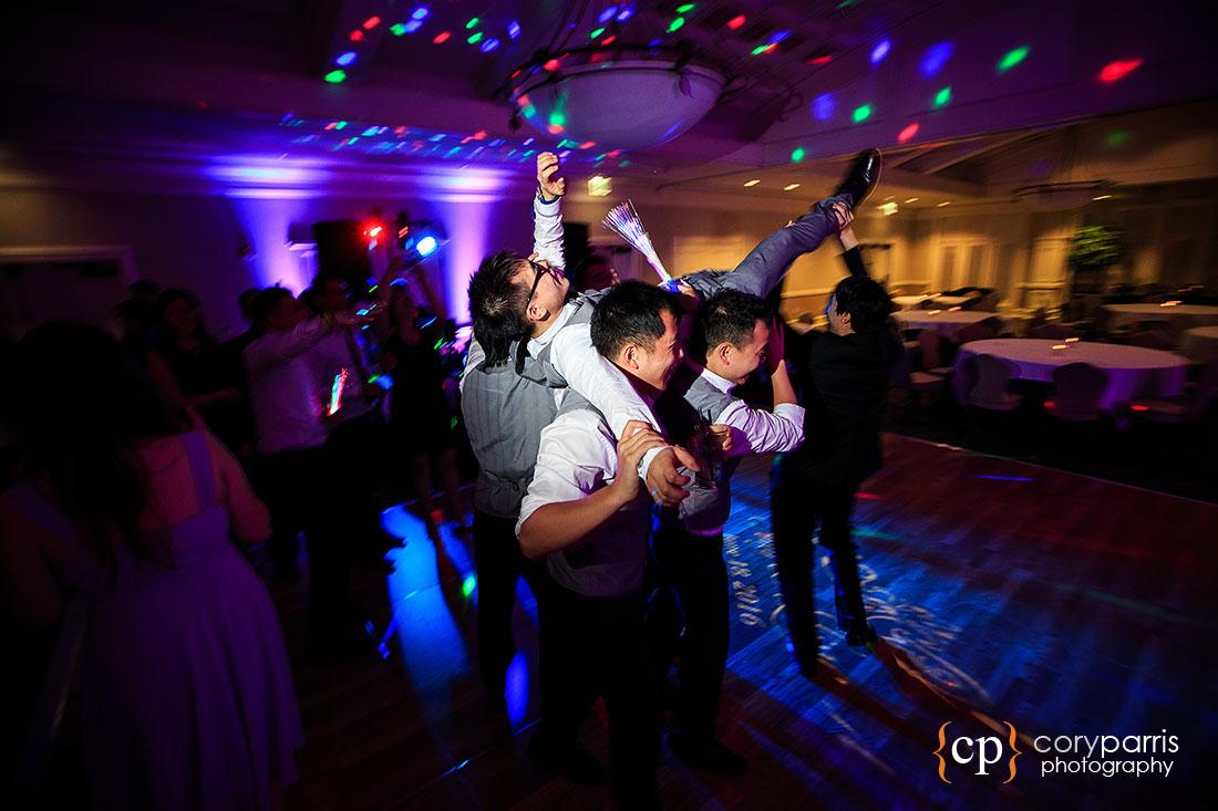 Groom getting carried through the dance floor