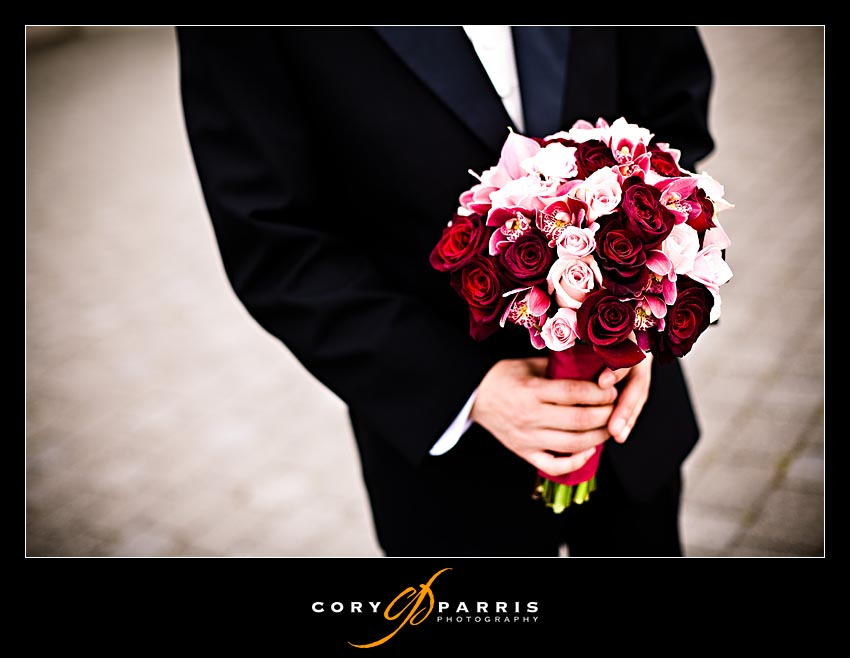 Groom waiting for the bride with her bouquet