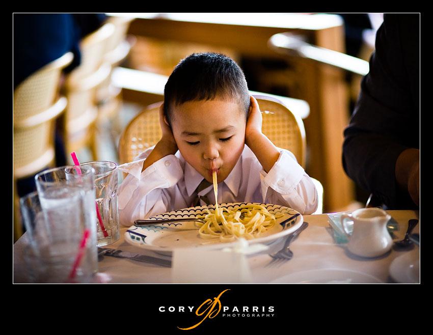 Boy sucking up a noodle