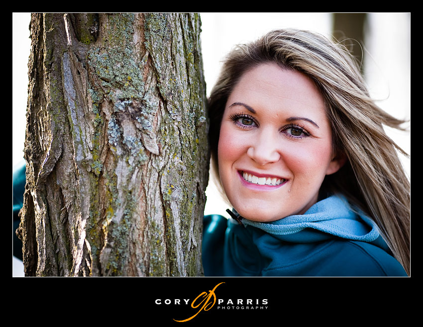 Carly against a tree