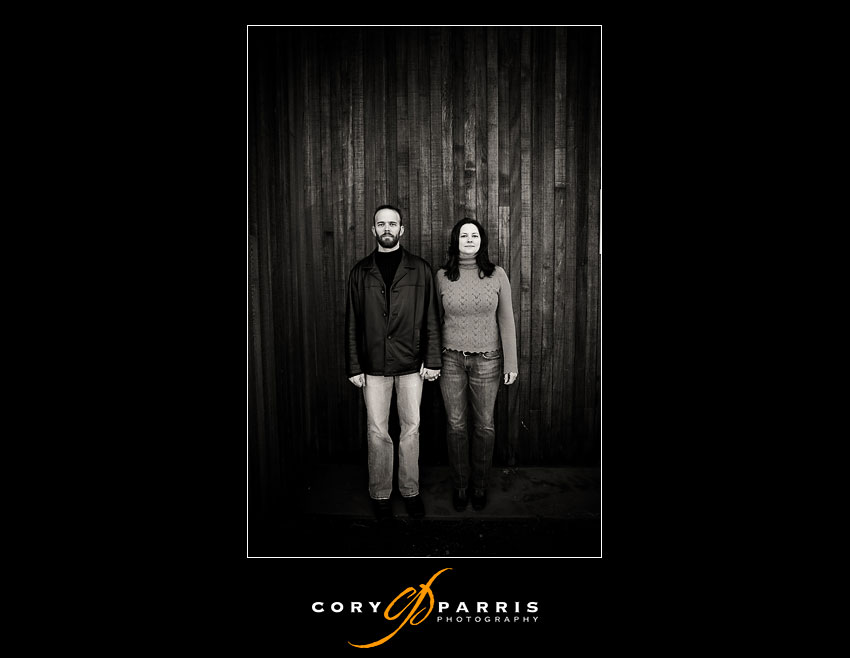 couple with wood wall