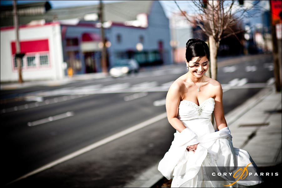 bride standing on the street waiting for her chariot...er...car