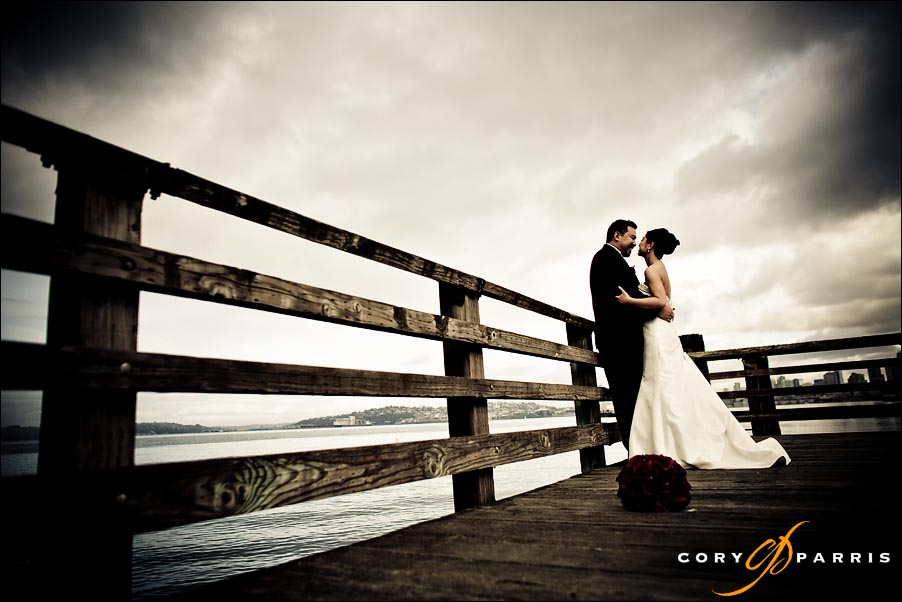 bride and groom on a dock on the seattle waterfront near alki beach