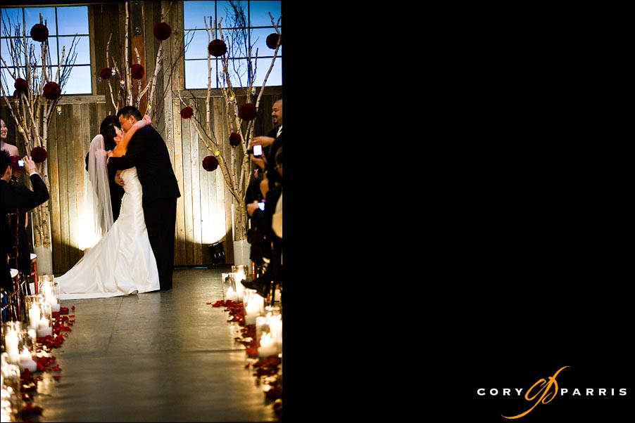 bride and groom first kiss at sodo park in seattle
