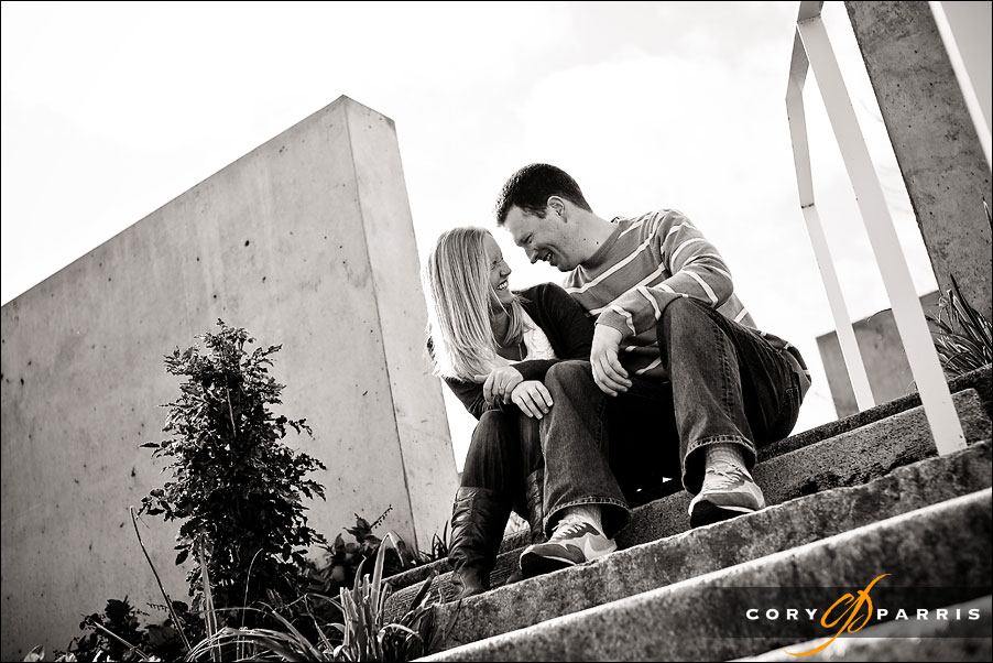 couple sitting on stone stairs at the olympic sculpture park in seattle