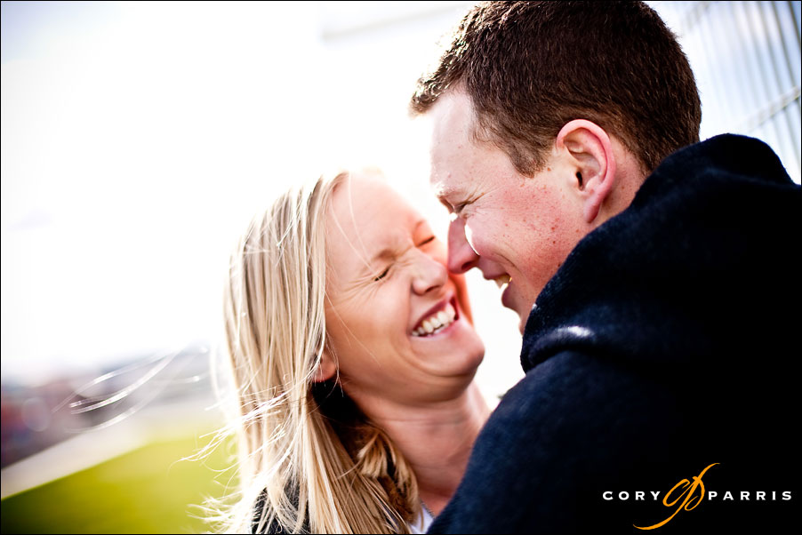 woman laughing at her fiance in an engagment portrait