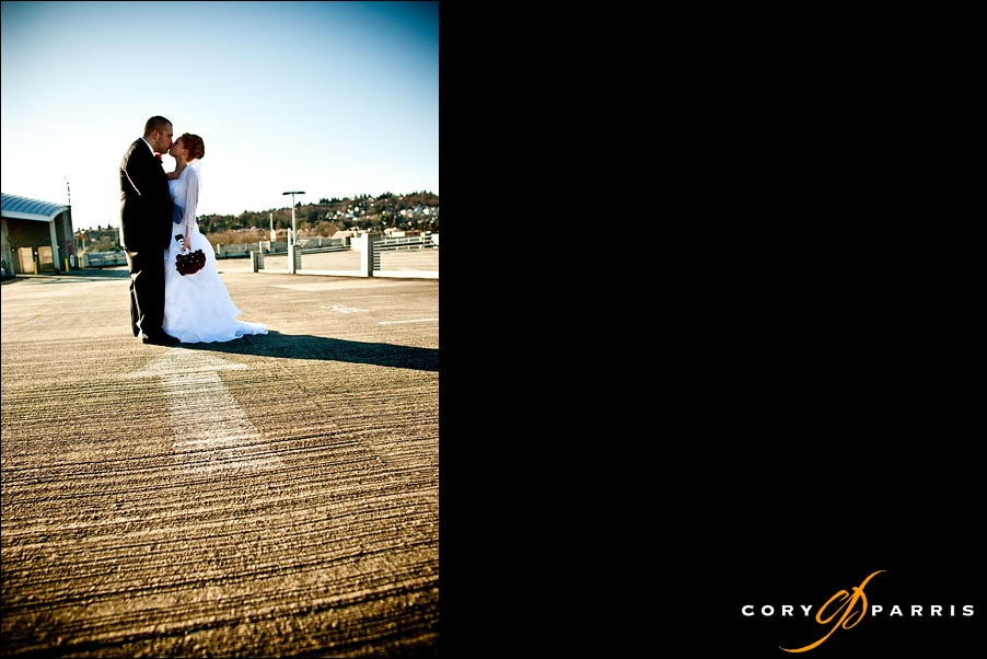 bride and groom in a parking garage with a painted arrow by seattle wedding photographer cory parris