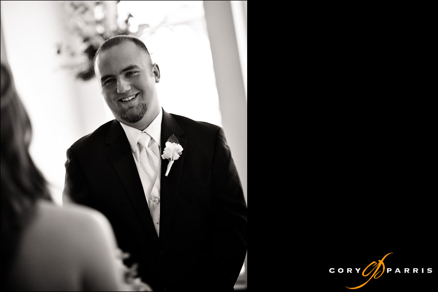 groom smiling as he sees his first look of his bride