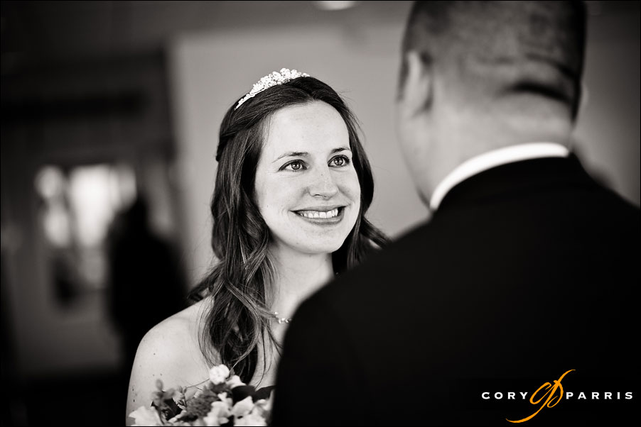 bride smiling at groom during first look by seattle wedding photographer cory parris