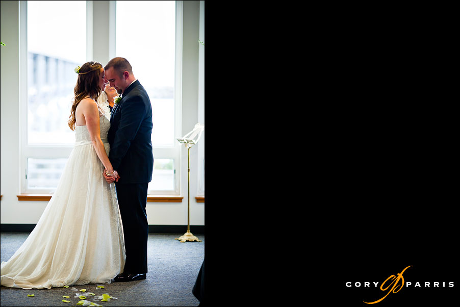 bride and groom during the ceremony at the edmonds yacht club