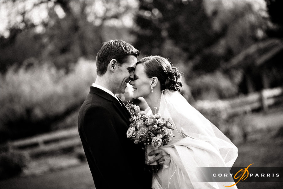 bride and groom have their first look as photographed by seattle wedding photojournalist cory parris