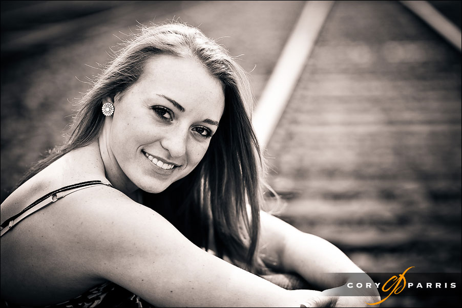 portrait of a senior girl on the railroad track