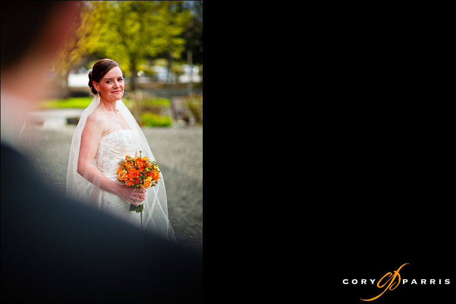 portrait of the bride looking over the should of the groom by seattle wedding photographer cory parris