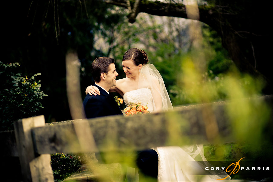 portrait of the bride and groom with an old fence at pickering barn in issaquah by seattle wedding photographer cory parris