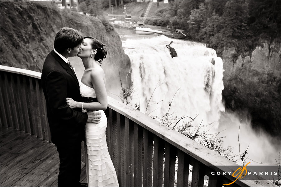 portrait of a couple by Snoqualmie Falls near Seattle