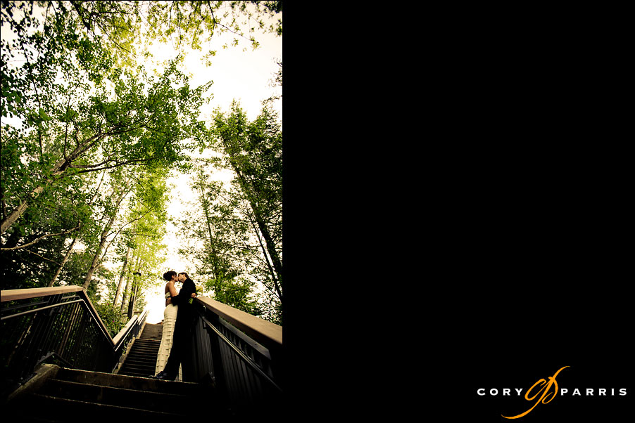 portrait of a wedding couple on stairs at the snoqualmie falls park by seattle wedding photographer cory parris