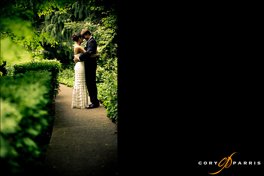 portrait of a couple in a garden at salish lodge by seattle wedding photographer cory parris