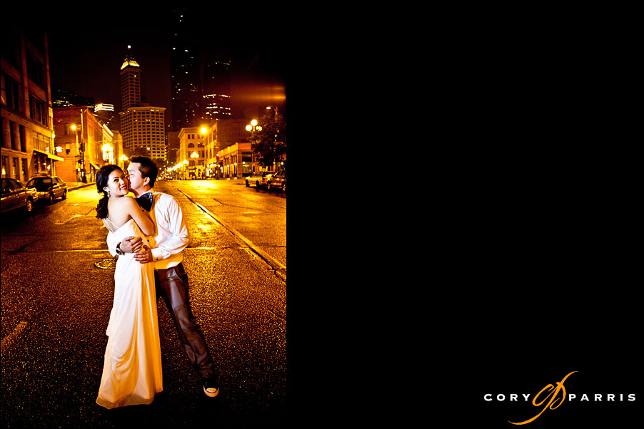 wedding couple standing on the rainy street of downtown seattle