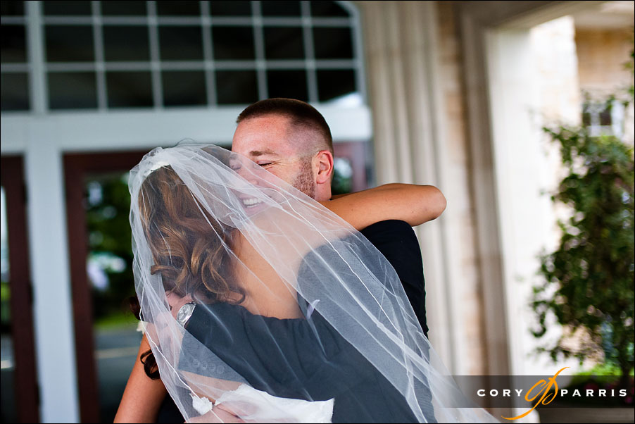 happy groom hugging the bride at first look by seattle wedding photojournalist