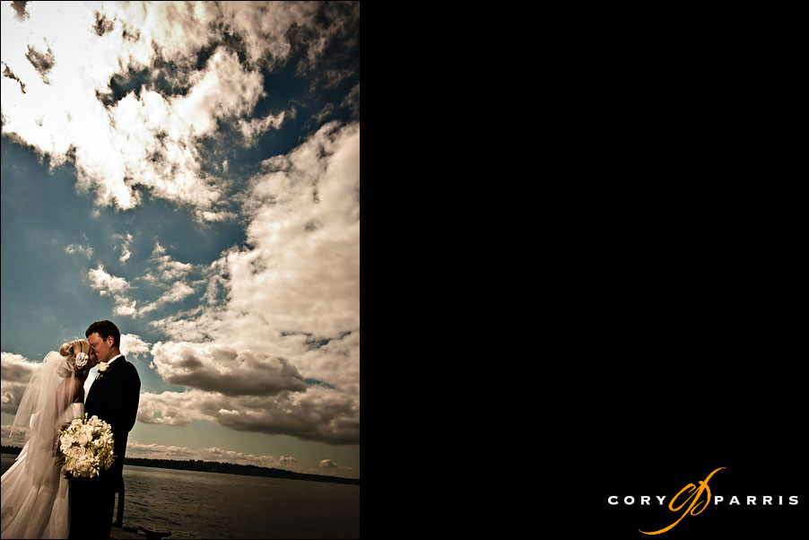 bride and groom with a dramatic sky by seattle wedding photographer cory parris