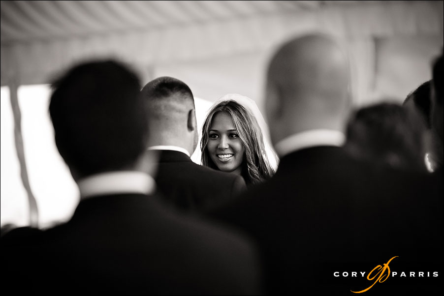 bride looking at groom during wedding ceremony at the newcastle golf club