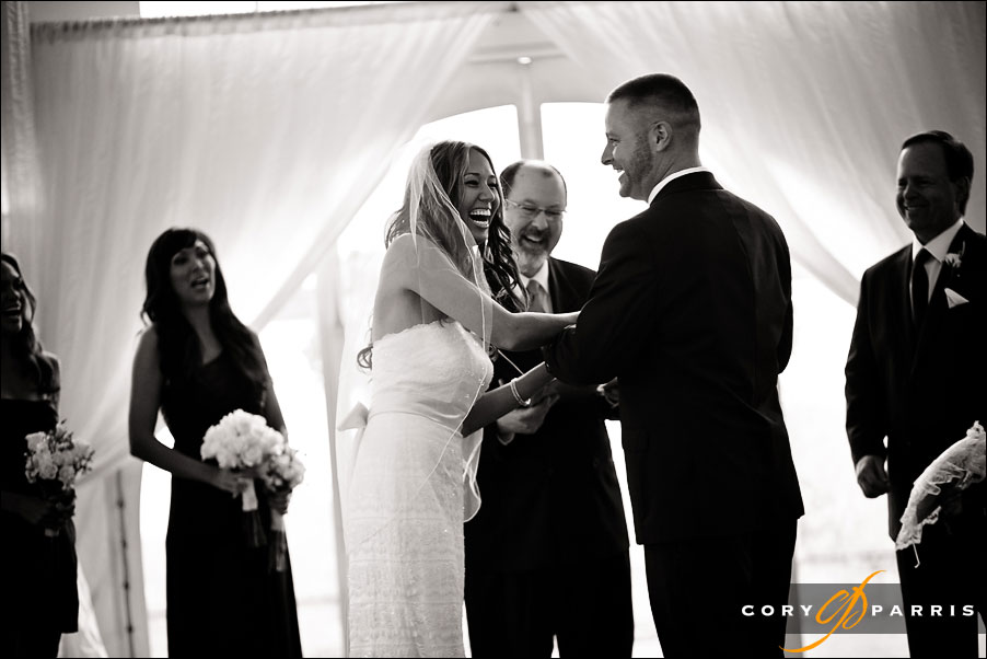 bride and groom having fun during the ceremony in the tent at newcastle golf club wedding