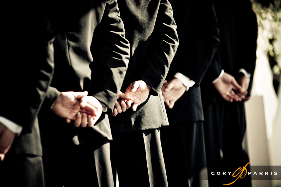 groomsmen's hands during the wedding ceremony by seattle wedding photographer cory parris