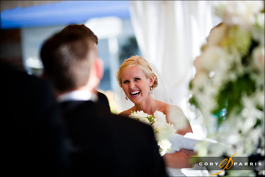 bride laughing during wedding by seattle wedding photojournalist cory parris