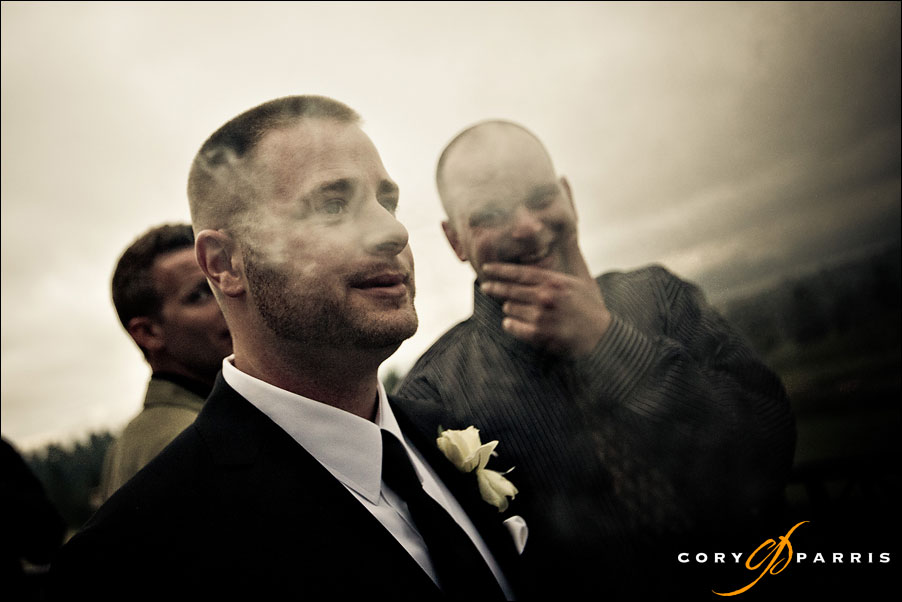 groom in the smoke and clouds by seattle wedding photojournalist cory parris