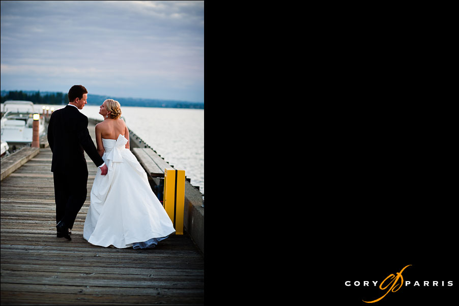 bride and groom walking on the dock by seattle wedding photographer cory parris