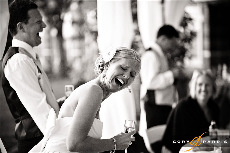 bride laughing during best man's toast by seattle wedding photojournalist cory parris