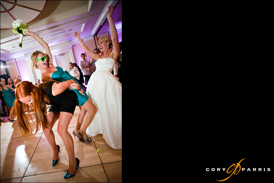 girls fighting over the bouquet as the bride cheers by seattle wedding photojournalist cory parris