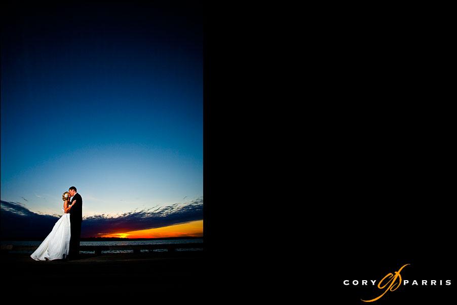bride and groom sunset portrait on lake washington at the woodmark hotel by seattle wedding photographer cory parris