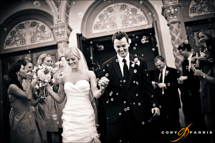 bride and groom coming out of the church with bubbles by seattle wedding photojournalist cory parris