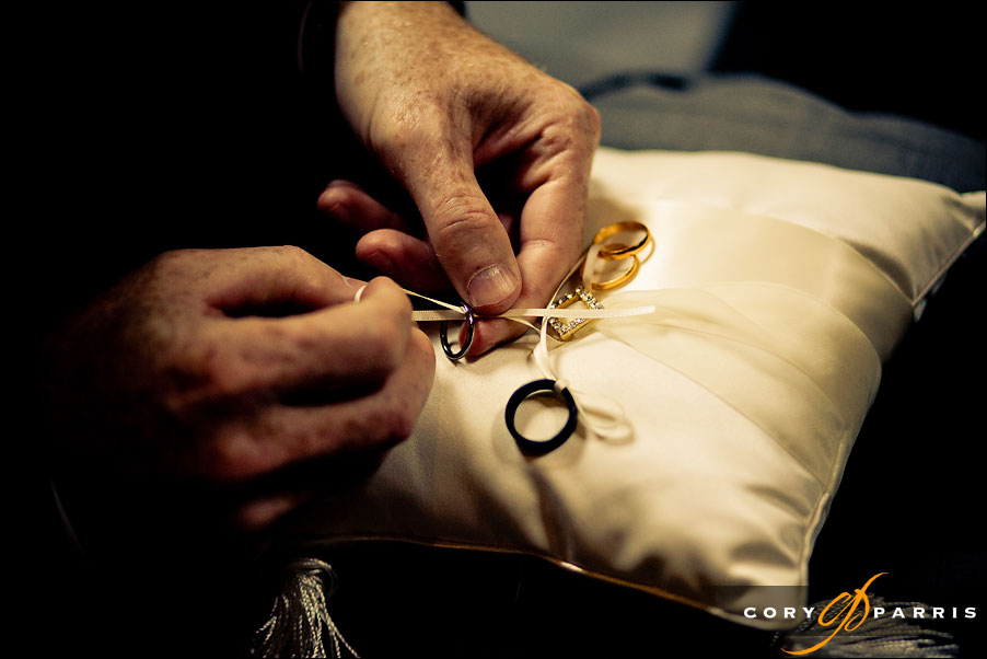 tying the rings on the pillow by seattle wedding photojournalist cory parris