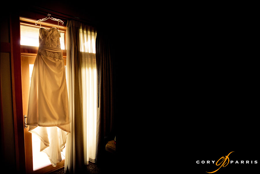 dress hanging in the window by seattle wedding photojournalist cory parris