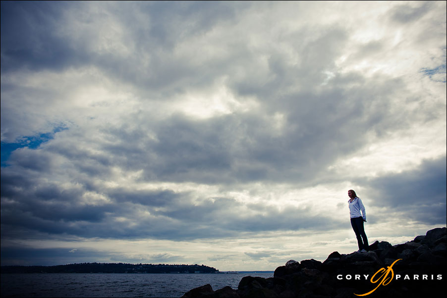 senior girl on the water with dramatic sky by seattle portrait photographer cory parris