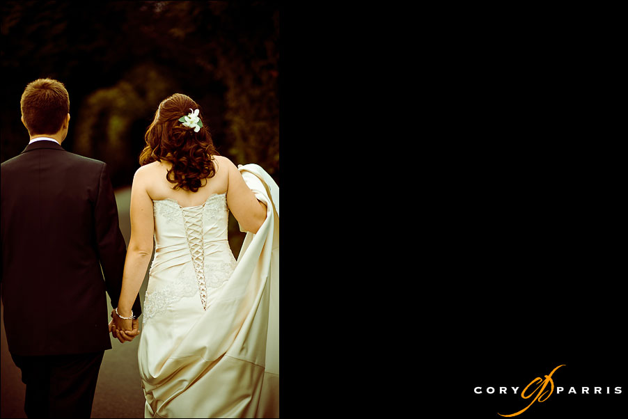 bride and groom walking away by seattle wedding photographer cory parris