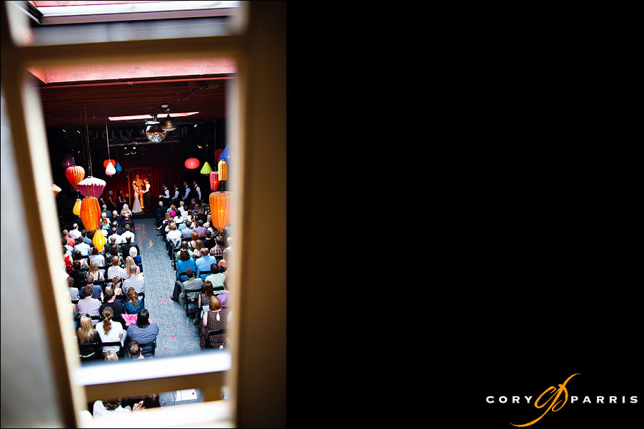 peaking through the loft window at the georgetown ballroom by seattle wedding photojournalist cory parris