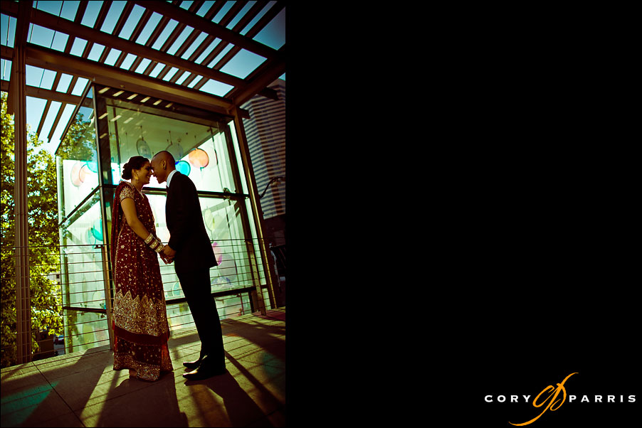 bride and groom kissing in downtown seattle by seattle wedding photographer cory parris