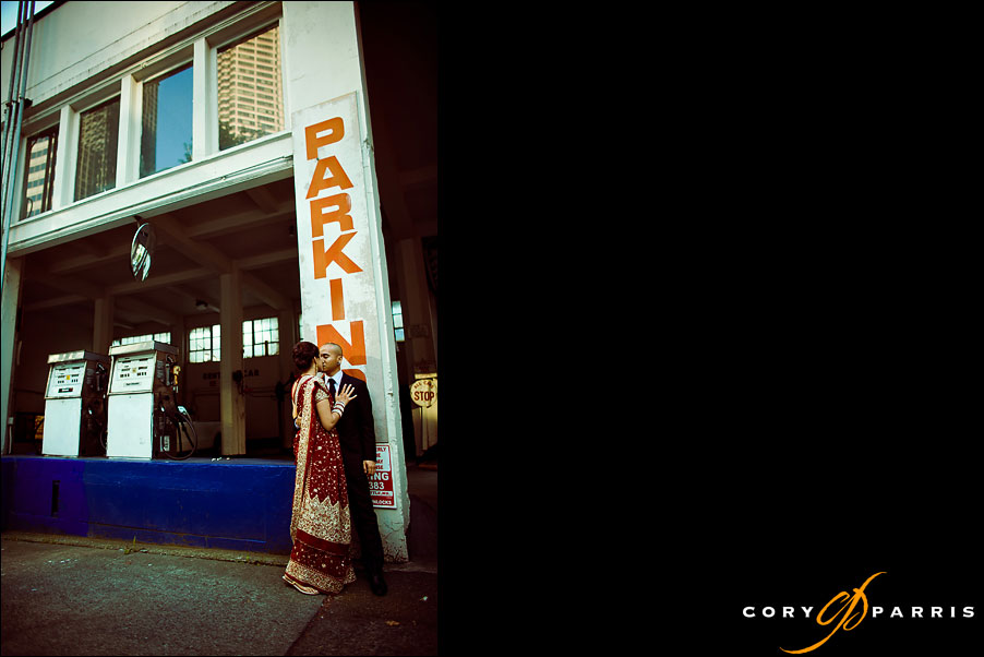 bride and groom kissing at a gas station in seattle wedding photographer cory parris